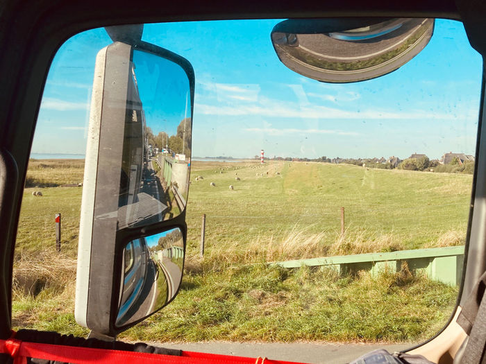 Scenic view of landscape seen through car window