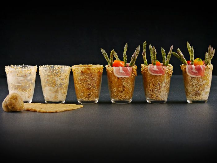 Close-up of served food on table against black background