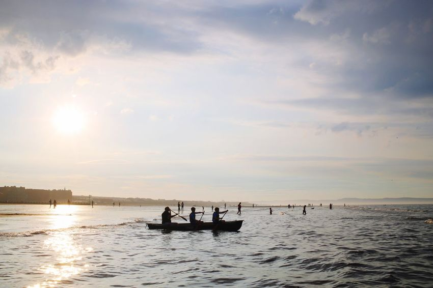 Beach Canoeing Boat Water Nautical Vessel Sky Transportation Mode Of Transportation Group Of People Sea Waterfront Silhouette Leisure Activity Outdoors Real People