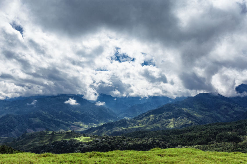 Valleys and dramatic clouds outside of Salento, Colombia. Cloud Colombia Farm Hiking Palm Pasture Quindío Rural Tree Trip Andean Cauca Colombian  Countryside Forest Hike Jeep Landscape Mountain Quindío Range Salento Tolima Trek Wax