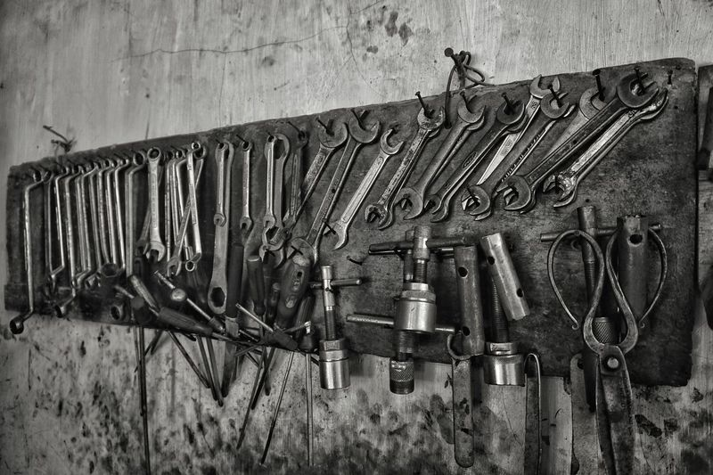 Hand tools hanging on wall