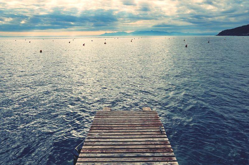 Pier over sea against sky