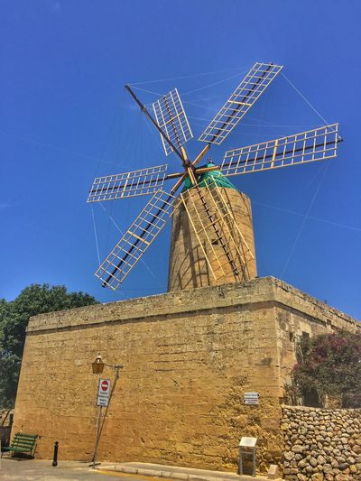 Windmill in Gozo, Malta Alternative Energy Architecture Blue Built Structure Clear Sky Day Environmental Conservation Fuel And Power Generation Industrial Windmill Low Angle View Nature No People Outdoors Renewable Energy Rural Scene Sky Traditional Windmill Wind Power Wind Turbine Windmill