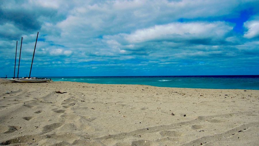 Sea Beach Cloud - Sky Water Sky Horizon Over Water Sand Beauty In Nature Tranquil Scene Nature Tranquility Scenics No People Outdoors Nautical Vessel Day Moody Sky Moody Nature Moody Weather Caribbean Varadero, Cuba Boats Beach Photography Moody Skies  Sand & Sea