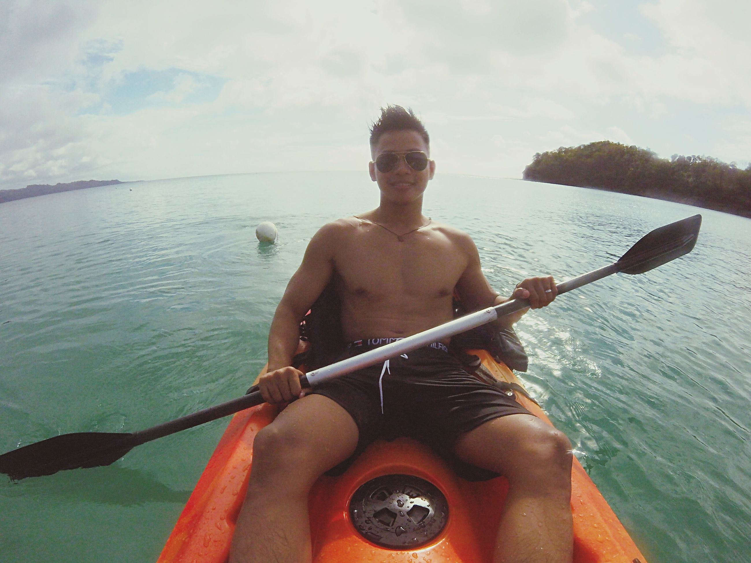 sea, leisure activity, one person, real people, shirtless, front view, vacations, men, cloud - sky, young adult, horizon over water, water, day, beach, outdoors, sport, one man only, adults only, sky, only men, adult, nature, oar, beauty in nature, people, sportsman
