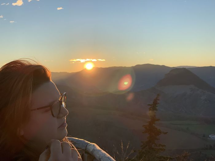 Reflection Sky Real People One Person Leisure Activity Sunset Lifestyles Headshot Portrait Young Adult Women Mountain Nature Young Women Sunlight Non-urban Scene Glasses Adult Mountain Range Sun Beauty In Nature