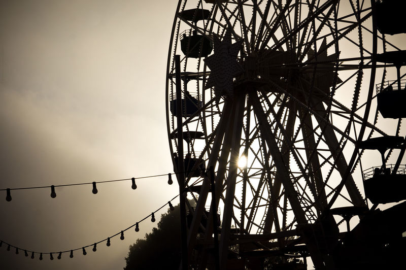 big ferris wheel Riesenrad in the sun evening Tibidabo Barcelona Amusement  Barcelona Carnival Carousel Circle Circus Entertainment Fairground Family Ferris Wheel Holiday Joy Leisure Low Angle View Park Silhouette Silhouette Sky Sundown Sunset Tibidabo Carnival Crowds And Details
