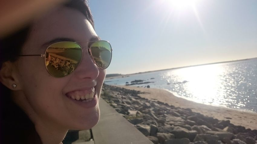 Perfectsmile Perfectperson Perfectspot Sea Beach Sunlight Water Sunglasses Tilt Horizon Over Water Sunny Sunbeam Lens Flare Clear Sky Scenics Headshot Leisure Activity Bright Sun Vacations Lifestyles Reflection Tranquil Scene Women Around The World