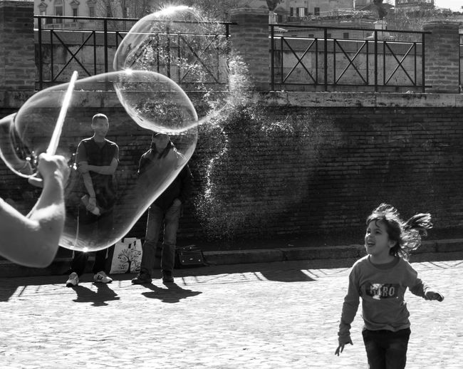 B&W Collection Bubbles Fun Funny Travel Black And White Bubble Wand Childhood Lifestyles Outdoors Play Playing Real People Street Street Photography Travel Destinations Connected By Travel