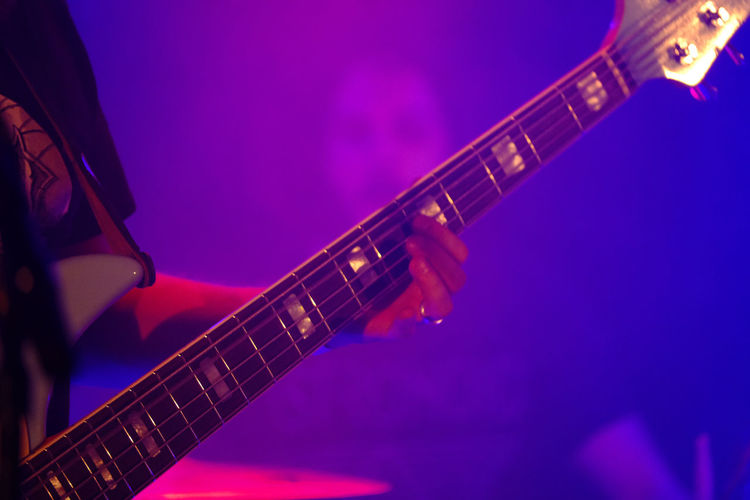 Music Musical Instrument Guitar Arts Culture And Entertainment String Instrument Musical Equipment Performance Close-up Purple Electric Guitar String Musical Instrument String No People Playing Fretboard Indoors  Rock Music Night Nightlife Stage