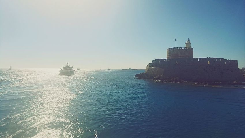Leaving the harbour Boat View From A Boat Sunshine Castle Between The Collusus No People History Greece Outdoors Travel Destinations Tourism Vacations Tranquil Scene Tranquility Built Structure Bay Water Coastline Waterfront Shore Sky Sea Lifestyles On A Boat