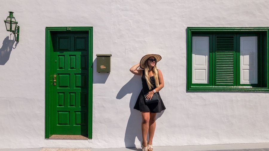 Stylish Women One Person Built Structure Standing Architecture Building Exterior Real People Green Color Casual Clothing Women Day Sunlight Young Women Lifestyles Wall - Building Feature Clothing Adult Leisure Activity Outdoors Young Adult My Best Travel Photo