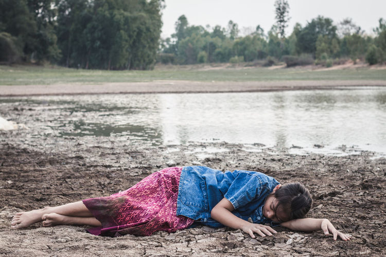 Girl Lying On Drought Land