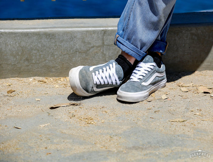 Low section of man wearing canvas shoes
