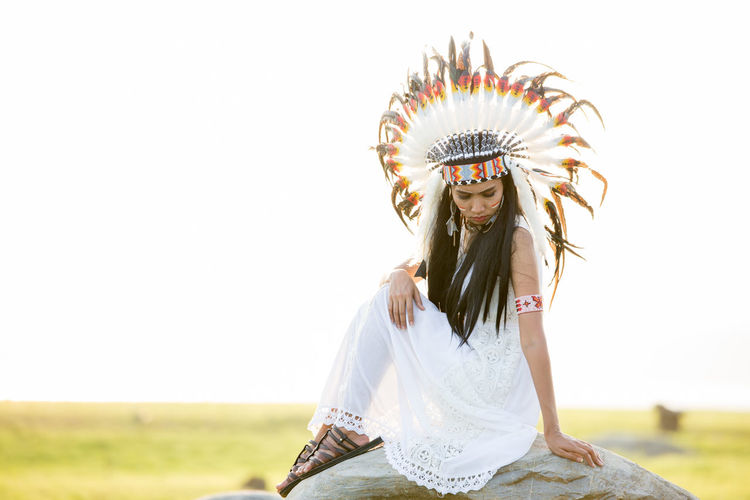 Clear Sky Clothing Copy Space Day Front View Fun Hairstyle Headdress Leisure Activity Lifestyles Nature One Person Portrait Real People Sky Standing Three Quarter Length Traditional Clothing Women Young Adult Young Women