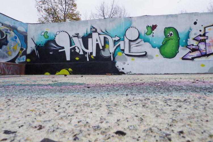 Graffiti on wall by playground