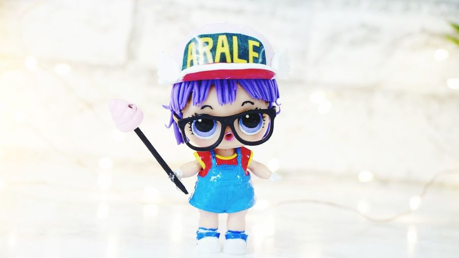 L.O.L Surprise Arale Custom Doll Hat Purple Pink Poop Collection Action Figures Lol Surprise Arale ARALE-chan Cartoon Dollart Doll Repainting EyeEm Selects Childhood Front View Creativity Art And Craft Toy Blue Innocence