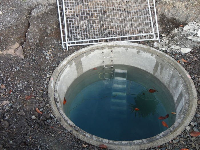 High Angle View Of Water In Manhole