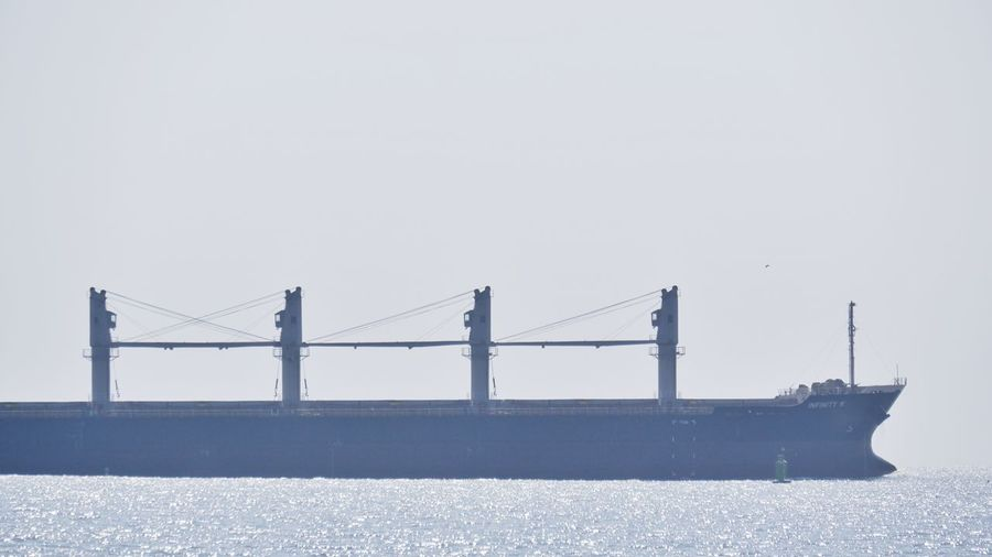 Bridge over sea against clear sky