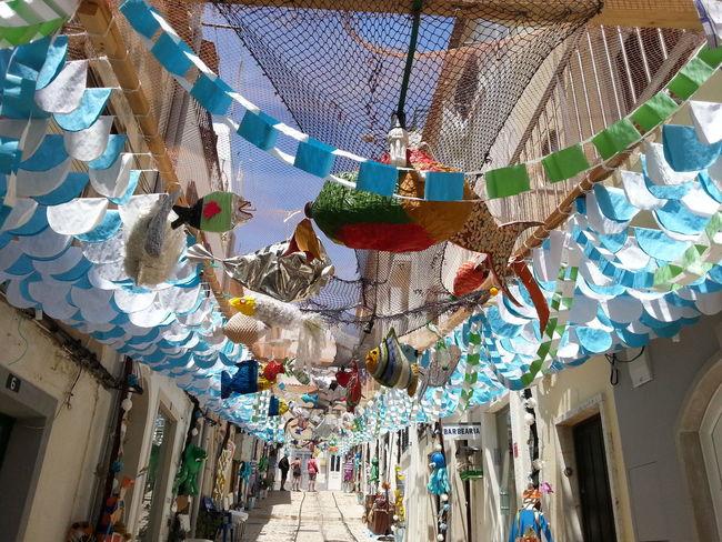 Street Fashion Street Photography Decorated Street Sesimbra Portugal Holydays The Street Photographer - 2016 EyeEm Awards