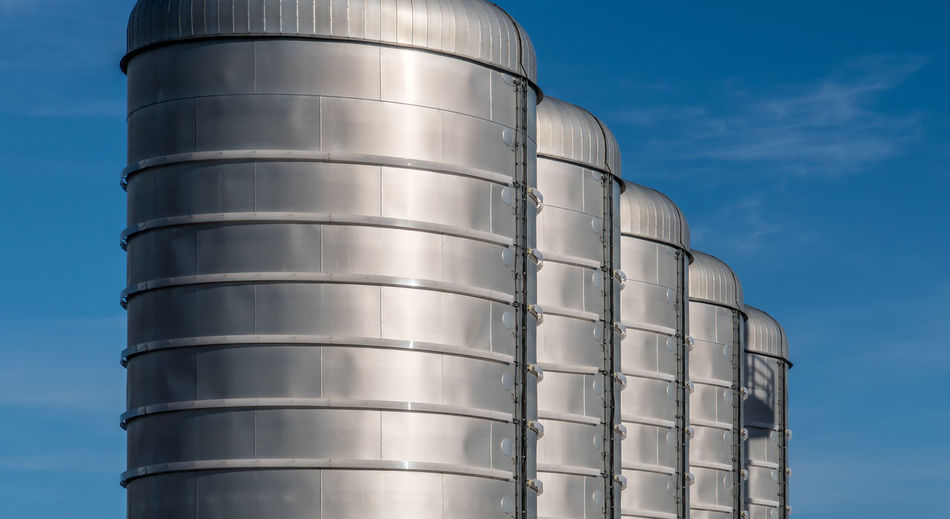 Industrial Industrial Photography Industry Production Agriculture Blue Sky Clear Sky Day Factory Food And Drink Industry Gas Tank Industry Low Angle View Manufacturing Metal Metallic No People Outdoors Petrol Petrol Tank Silo Sky Storage Compartment Storage Tank Sunlight