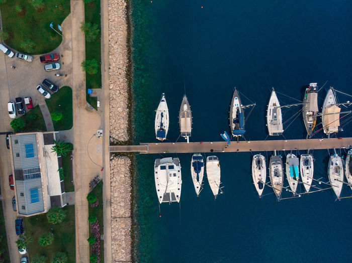 Aerial view of marina with lots of yachts. Water Architecture Transportation Built Structure Building Exterior Nature Mode Of Transportation Nautical Vessel Day No People High Angle View Sea Harbor Outdoors City Reflection Building Moored Travel Drone  Aerial View Marina Yacht Ship Boat