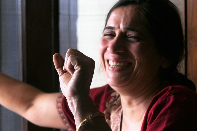 Close-Up Of Cheerful Woman With Clenched Fist