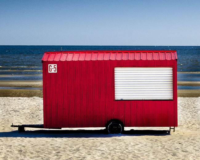 Beach Blue Closed Day Graphic Horizon Over Water Nature No People Outdoors Red Red Safety Sea Shore Sky Trailer Tranquil Scene Tranquility Vender Water Fine Art Photography