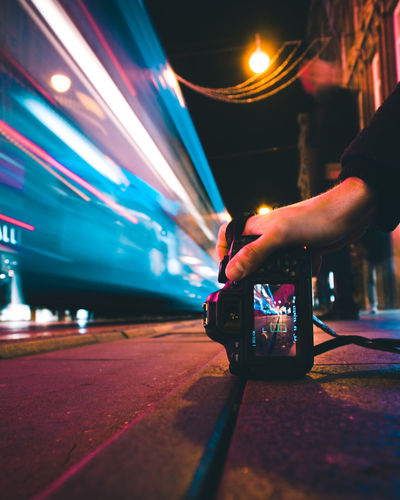 Long exposure shot of a tram and dslr during night in Zagreb Camera DSLR Long Exposure Shot Nightphotography Tram Bokeh Hand Human Body Part Human Hand Illuminated Long Exposure Long Exposure Night Photography Long Exposure Photography Long Exposures Night One Person Real People EyeEmNewHere
