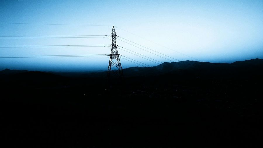 Electricity pylons on landscape