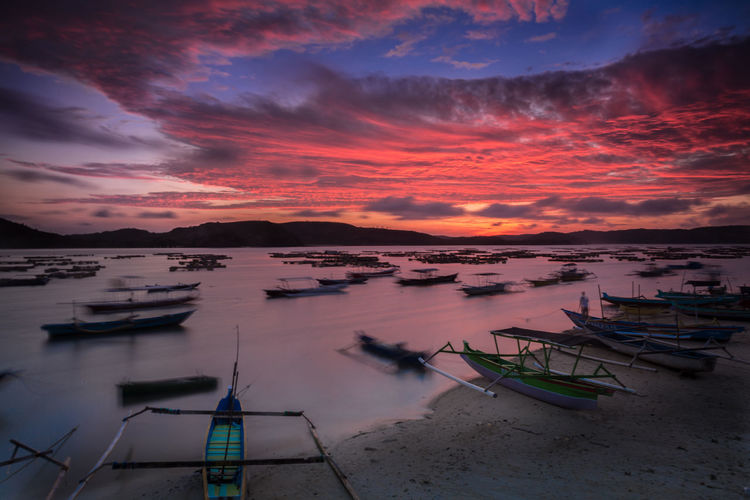 Sunrise at Gerupuk Beach, Lombok, Indonesia. Lombok-Indonesia Beauty In Nature Boat Cloud - Sky Day Gerupukbeach Mode Of Transport Moored Nature Nautical Vessel No People Outdoors Outrigger Scenics Sea Sky Sunset Tranquility Transportation Water