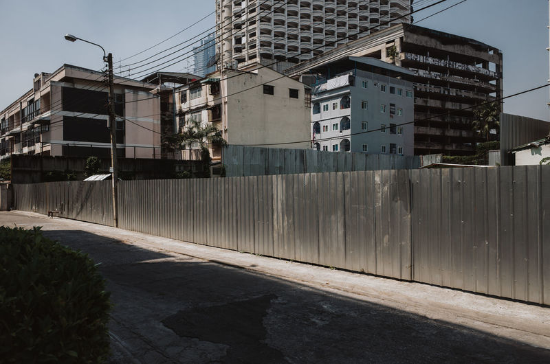 Residential area and empty street in Bangkok, Thailand Built Structure Building Exterior Architecture Building City Nature No People Day Outdoors Sky Sunlight Residential District Street Road Industry Motion Plant Wall Water Residential