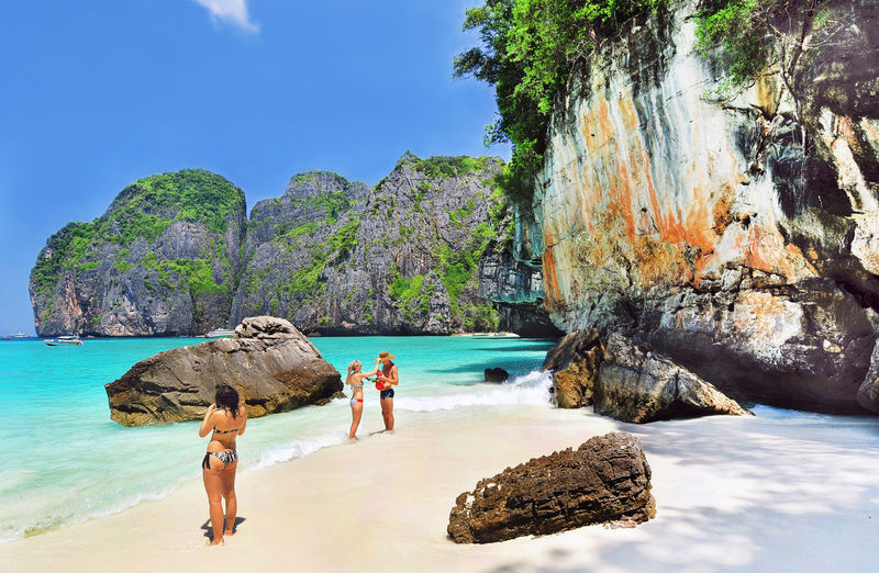 Phi Phi Maya Bay, Thailand Adult Adults Only Beach Beauty In Nature Day Human Body Part Island Islands Maya Bay Nature One Person Outdoors People Phi Phi Rock - Object Sand Scenics Sea Thailand Travel Travel Destinations Tropical Climate Vacations Water ısland