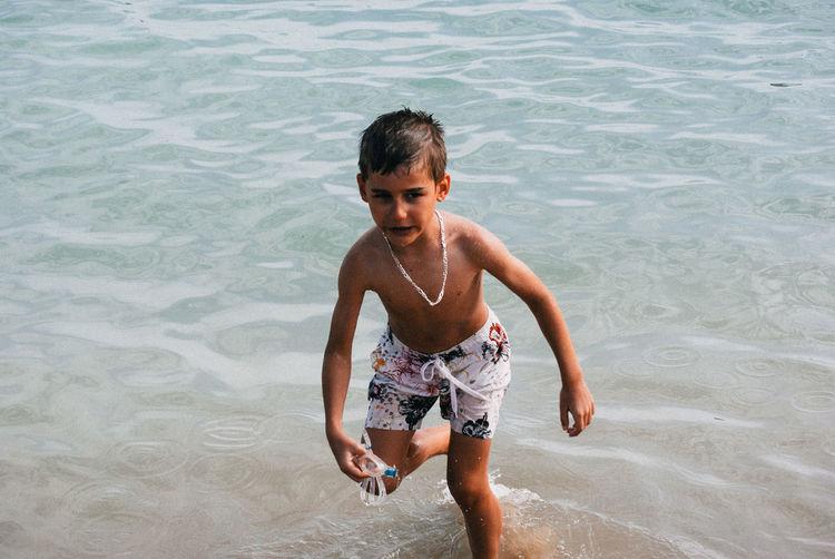 Boy Running In Sea