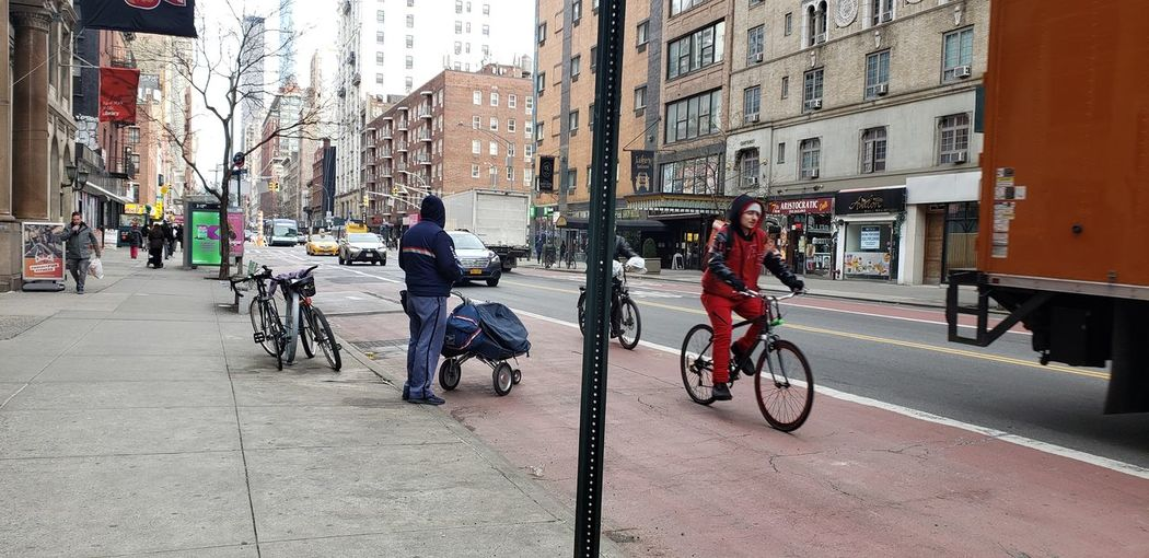 Bicycles on street by buildings in city