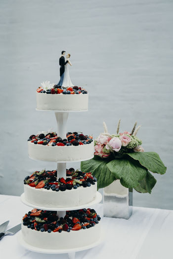Bride and groom on top of the wedding cake. Photos taken during a wedding in Copenhagen, Denmark. Bride Groom Wedding Wedding Photography Wedding Ceremony Wedding Day Wedding Cake Cutting Indoors  Celebrating Love Newlyweds Real Wedding Sweet Food Dessert Cake Sweet Food And Drink Food Freshness Baked Indulgence Unhealthy Eating Temptation No People Flower Table Celebration Flowering Plant Ready-to-eat Event