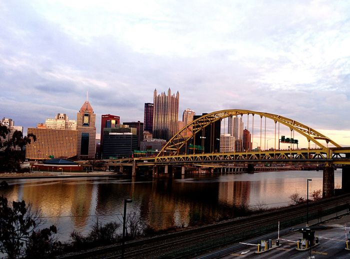 Fort Duquesne Bridge Over Allegheny River By Cityscape Against Sky