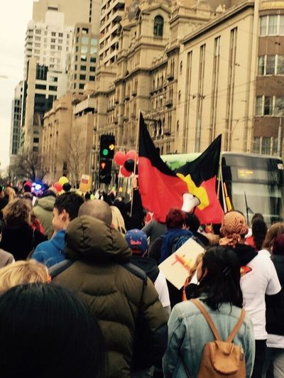 Here Belongs To Me Aboriginal Land Aboriginal Flag Aboriginal Language Naidoc Week Strong Culture March Standing Tall Strong Proud Red Yellow Black Traffic Traffic Lights People Photography People City Street Peoplephotography Buildings Old Buildings