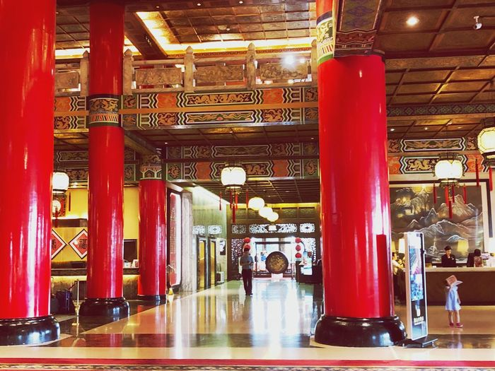 Indoor Photography series: The Taipei Grand Hotel Grand Hotel Taipei Indoor Photography My Asia Trip 2018 Reflection Indoors  Architecture Built Structure Incidental People Travel Illuminated Architectural Column Real People Group Of People Flooring Travel Destinations Building City Red People Text Women