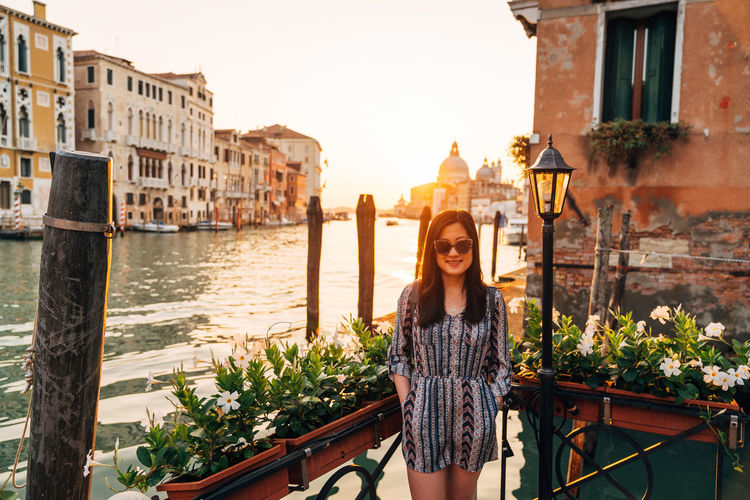 Portrait Of Woman Standing By Canal Against Santa Maria Della Salute