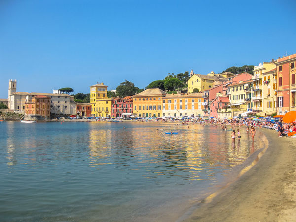 Sestri Levante, Liguria, Italy - circa June 2010: the spectacular beach of the Bay of Silence with colorful houses reflected in the sea. Famous Italian seaside resort. City Genova Harbour Portofino Skyline Aerial View Architecture Baia Del Silenzio Bay Beach Blue Boats Building Exterior Built Structure Cistyscape City Clear Sky Day Fishing Italy Liguria Marine Nature No People Outdoors Sea Seascape Ships Silence Sky Town Travel Destinations Village Vip Water Waterfront Yacht