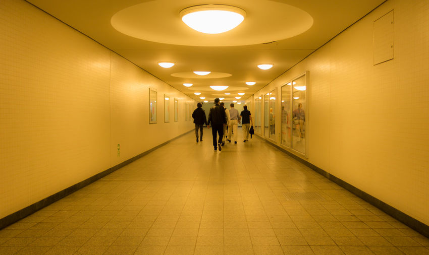 Architecture Architecture Built Structure Ceiling City Life Corridor Diminishing Perspective Flooring Full Length Fußgängertunnel Illuminated Lamp Leisure Activity Lifestyles Lighting Equipment Pedestrian Real People Symmetry The Architect - 2016 EyeEm Awards The Street Photographer - 2016 EyeEm Awards The Way Forward Tunnel U-Bahnhof Ubahnhof Underpass