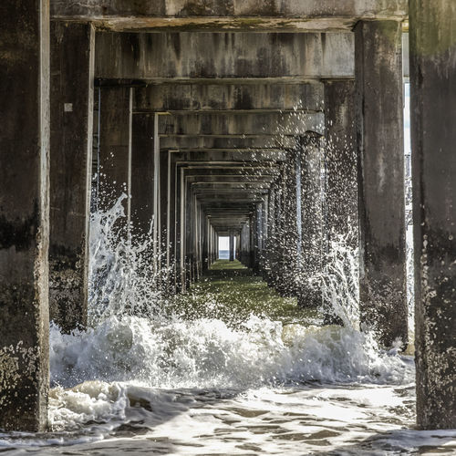 Pier Suds Sunlight Wave Architecture Beams Bridge - Man Made Structure Built Structure Connection Day Grunge Horizon Motion Nature No People Ocean Outdoors Persepective Pillars Splash Under Under A Pier Underneath Water