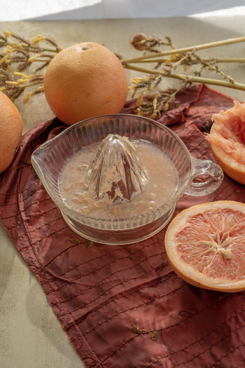 fresh grapefruit juice prepared by hand using a vintage glass juicer Food And Drink Food Healthy Eating Wellbeing Freshness Fruit Citrus Fruit SLICE No People Grapefruit Juice Juicer Grapefruit Juice Fresh Squeezed Healthy Drink Breakfast Drink