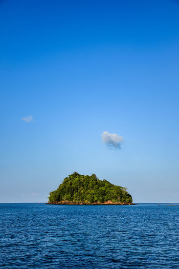 Single island in the middle of the sea Sky Water Beauty In Nature Scenics - Nature Tranquil Scene Blue Tranquility Sea No People Nature Day Waterfront Idyllic Horizon Over Water Plant Copy Space Horizon Tree Non-urban Scene Outdoors