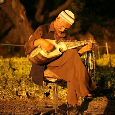 Location: Daman-e-Koh, Islamabad, Pakistan. We always saw him in a trance-like reverie, playing the most beautiful melodies on kabuli Rebab (a lute-like musical instrument, originally from Afghanistan) , each time we visited this place. He always sat like this, utterly detached from his surroundings - as if his soul had been unchained and transcended somewhere into the skies. He spoke very little, and demanded nothing. Standing near him on this bench, in the very heart of Margalla Hills, with the cool breeze teasing our hair into a dance, and the soft notes of Rebab seeping in through our curled toes, I realize how the best things in life are free. Streetlife Theroadsidelife