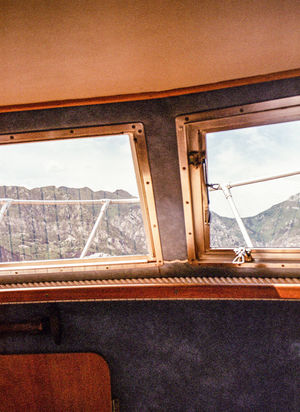 The Traveler - 2018 EyeEm Awards Absence Cloud - Sky Day Glass - Material Indoors  Mode Of Transportation Nature Nautical Vessel No People Passenger Craft Rail Transportation Seat Sky Transparent Transportation Travel Vehicle Interior Window Window Frame Wood - Material