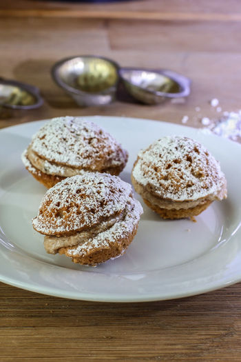 Three sweet Slovakian cookies with cream inside on white plate with forms Close-up Cookie Creativity Culinary Delicious Dessert Food Food And Drink Freshness Homemade No People Nut Plate Powdered Sugar Quality Slovakian Slovakian Food Suga Sweet Food