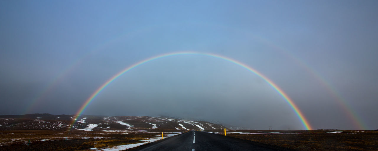 A rainbow is seen from Route 1 near Knappavellir, eastern Iceland November 9, 2012. Aurora Clear Sky Day Double Rainbow Iceland Mountain Nature No People Outdoors Rainbow Road S Scenics Sky Sun Sunset Tranquility Transportation Weather Winter