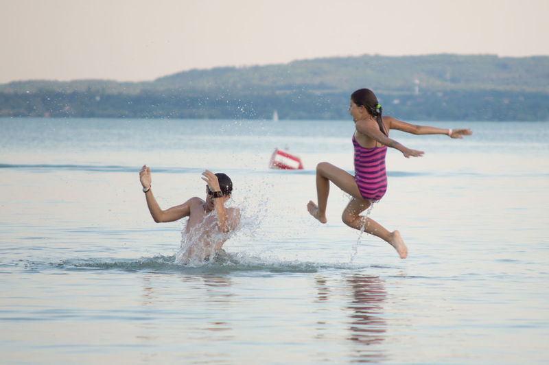 fun Beauty In Nature Casual Clothing Day Enjoyment Full Length Fun Jumping Leisure Activity Lifestyles Nature Outdoors Relaxation Scenics Sky Tranquil Scene Tranquility Vacations Water Waterfront